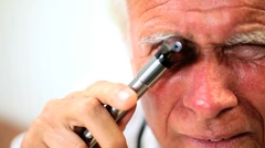 Senior Male Doctor Conducting Medical Examination Stock Footage
