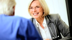 Mature Medical Consultant Conferring with Patient - stock footage
