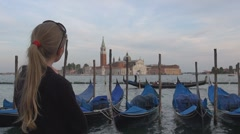 Girls looking for gondolas and San Giorgio Maggiore, Venice, Italy Stock Footage