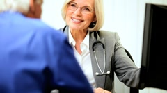 Female Medical Consultant in Office with Patient - stock footage
