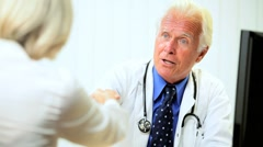 Mature Male Medical Consultant with Patient Stock Footage