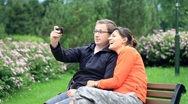Stock Video Footage of Young happy couple taking picture with mobile phone, outdoors HD