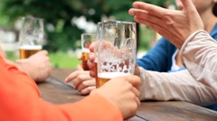Four friends drinking beer, outdoors HD Stock Footage