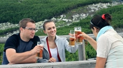 Three friends drinking beer, outdoors HD - stock footage