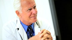 Senior Male Medical Consultant with Computer Stock Footage