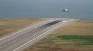 Landing plane near the sea Stock Footage