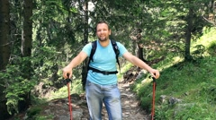 Portrait of young handsome hiker in the forest HD Stock Footage