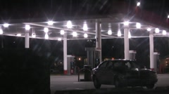Gass station at night kid on skateboard Stock Footage