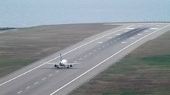 Plane takes off. Airport close to the sea. Stock Footage