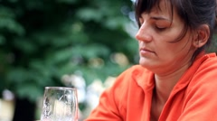 Sad woman drinking beer outdoors HD Stock Footage