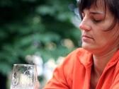 Sad woman drinking beer outdoors NTSC Stock Footage