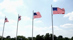 Four Flags in a row blowing in wind Stock Footage