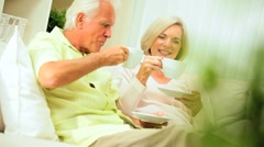 Senior Couple Enjoying Retirement Relaxing at Home Stock Footage