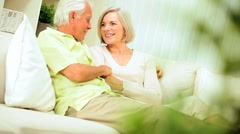 Senior Couple Enjoying Retirement Relaxing at Home - stock footage