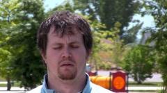 Man Sneezing Allergy season - stock footage