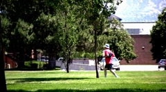 Man with hat running in the park - stock footage