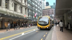 Yellow Bus in City Street,  Wellington, New Zealand Stock Footage