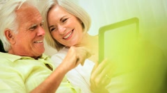 Retired Couple Using Wireless Tablet Technology Stock Footage