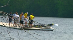 Men waiting coach and instructor before boarding their scull Stock Footage