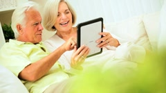 Mature Couple Using a Wireless Tablet at Home Stock Footage