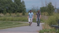 two guys walking and talking - stock footage