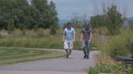 Stock Video Footage of two guys walking and talking