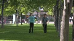 two people walking and sneezing allergie season - stock footage