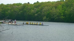 Sculling crew on the river for a day of training Stock Footage