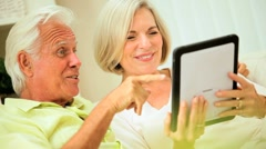 Senior Couple Talking Via Online Webchat Stock Footage