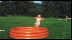 Little boy tumbling into pool (vintage 8 mm amateur film) Stock Footage