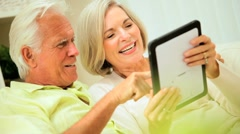 Mature Couple Using a Wireless Tablet Stock Footage