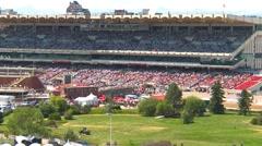 Stampede grandstand, long shot, decent afternoon crowd (interlace) - stock footage