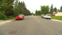 Drive plate, residential street #1, cloudy summer Stock Footage