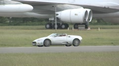 Spyker C8 Spyder supercar on race track Stock Footage