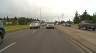 Drive plate, city road average traffic in the suburbs, cloudy Stock Footage