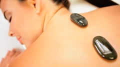 Health Spa Client Relaxing with Hot Stone Therapy Stock Footage