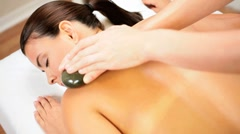 Beautiful Girl Having Hot Stone Massage Therapy Stock Footage