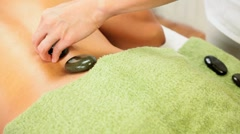 Stock Video Footage of Beautiful Ethnic Girl Having Hot Stone Massage Therapy