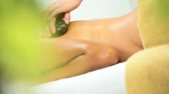 Female Spa Client Receiving Hot Stone Therapy Stock Footage