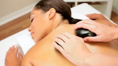 Beautiful Ethnic Girl Having Hot Stone Massage Therapy Stock Footage