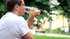 Man drinking beer outdoors Stock Footage