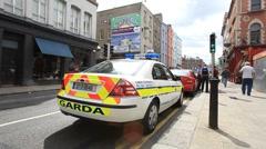 Irish Police Car in Dublin City Centre Stock Footage