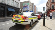 Irish Police Car in Dublin City Centre Stock Footage