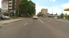 Drive plate, inner-city up hill with traffic Stock Footage