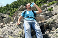 Male hiker drinking isotonic drink in the mountains Stock Footage