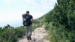 Stock Video Footage of Young man hiking in the mountains