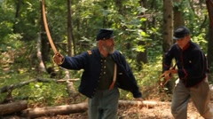 American Civil War soldiers charging past camera - stock footage