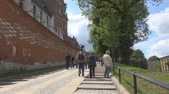 People going to the Wawel Royal Castle Krakow, Poland Stock Footage
