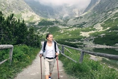 Stock Video Footage of Young woman hiking in the mountains, steadicam shot