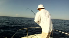 Reeling in Fish - stock footage
